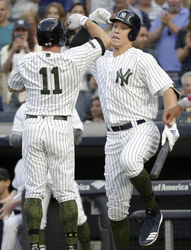 New York Yankees' Brett Gardner (11) celebrates his home run off Los Angeles Angels starting pitcher Jaime Barria with Aaron Judge, right, during the first inning of a baseball game Saturday, May 26, 2018, in New York. (AP Photo/Julio Cortez)