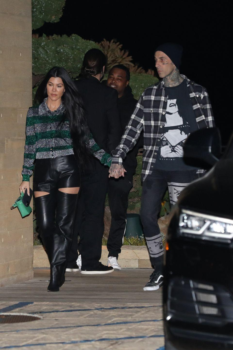 """<p>Normally, a gap this big between a couple, wouldn't be the best of signs, but Donaldson's reassured when she picks up on the couple's holding hands. """"Kourtney and Travis are holding hands tightly, fingers intertwined, palm touching palm, signaling their deep connection, and also signaling """"we're in love.""""'</p><p>Despite the distance between their bodies, Kourtney and Travis make sure they're keeping connected in some way. That physical move points to an authentic emotional one.<br></p>"""
