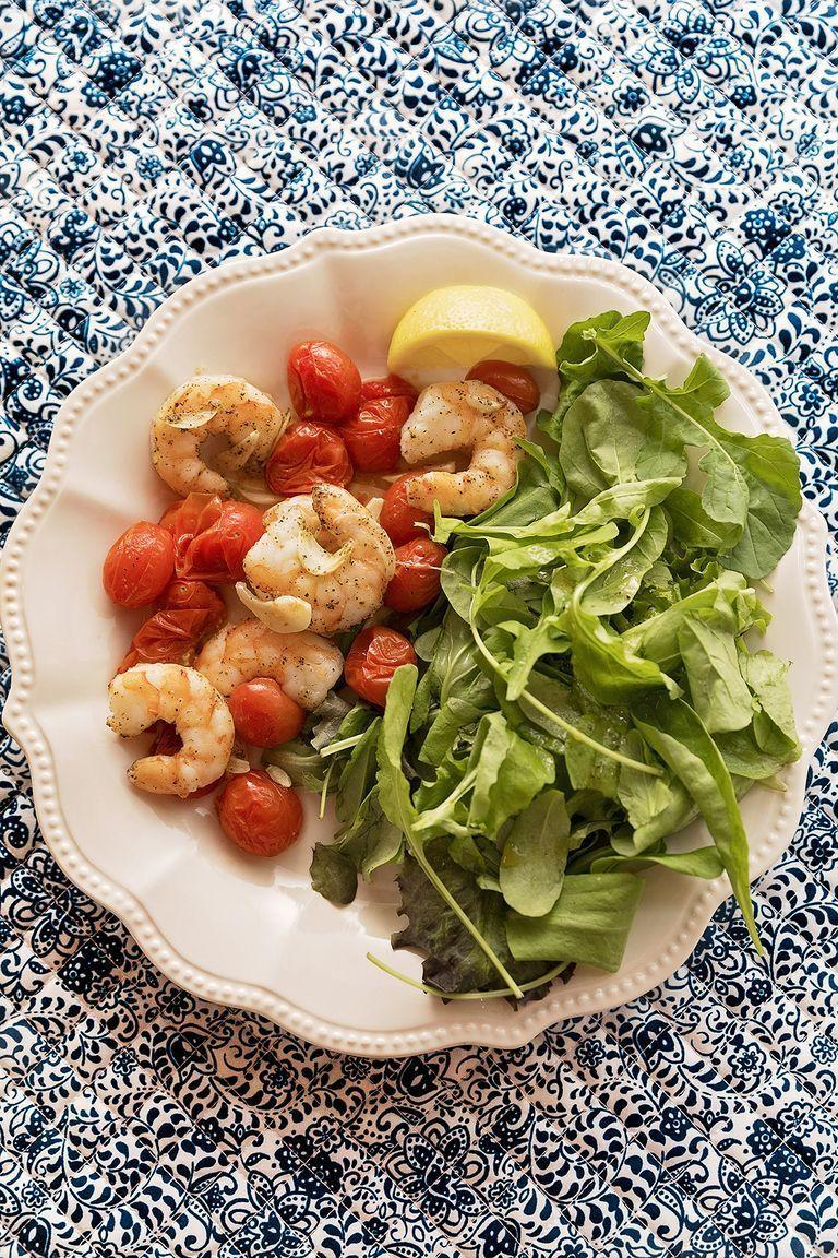 """<p>This quick sheet-pan dinner comes together in just 15 minutes! Serve it with salad, pasta, or just a hunk of crusty bread. </p><p><a href=""""https://www.thepioneerwoman.com/food-cooking/recipes/a93274/shrimp-tomato-sheet-pan-supper/"""" rel=""""nofollow noopener"""" target=""""_blank"""" data-ylk=""""slk:Get Ree's recipe."""" class=""""link rapid-noclick-resp""""><strong>Get Ree's recipe. </strong></a></p><p><a class=""""link rapid-noclick-resp"""" href=""""https://go.redirectingat.com?id=74968X1596630&url=https%3A%2F%2Fwww.walmart.com%2Fsearch%2F%3Fquery%3Dbaking%2Bsheet&sref=https%3A%2F%2Fwww.thepioneerwoman.com%2Ffood-cooking%2Fmeals-menus%2Fg36500577%2Ftomato-recipes%2F"""" rel=""""nofollow noopener"""" target=""""_blank"""" data-ylk=""""slk:SHOP BAKING SHEETS"""">SHOP BAKING SHEETS</a></p>"""