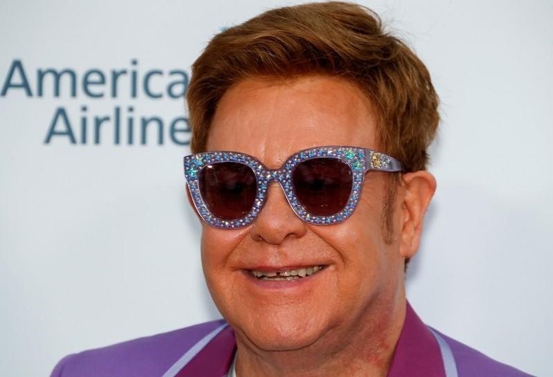 A day in Elton John's life - Buy Rolls, write hit song, dine with Ringo