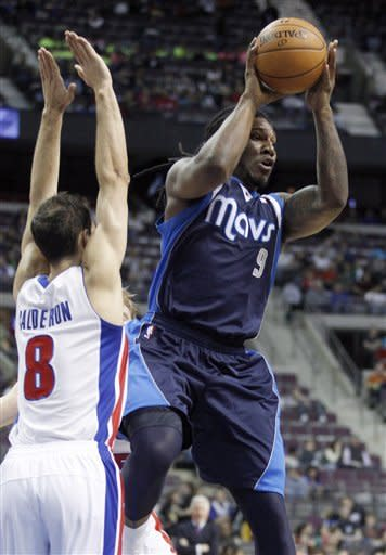 Dallas Mavericks forward Jae Crowder (9) passes the ball as Detroit Pistons guard Jose Calderon (8) defends during the first half of an NBA basketball game Friday, March 8, 2013, in Auburn Hills, Mich. (AP Photo/Duane Burleson)
