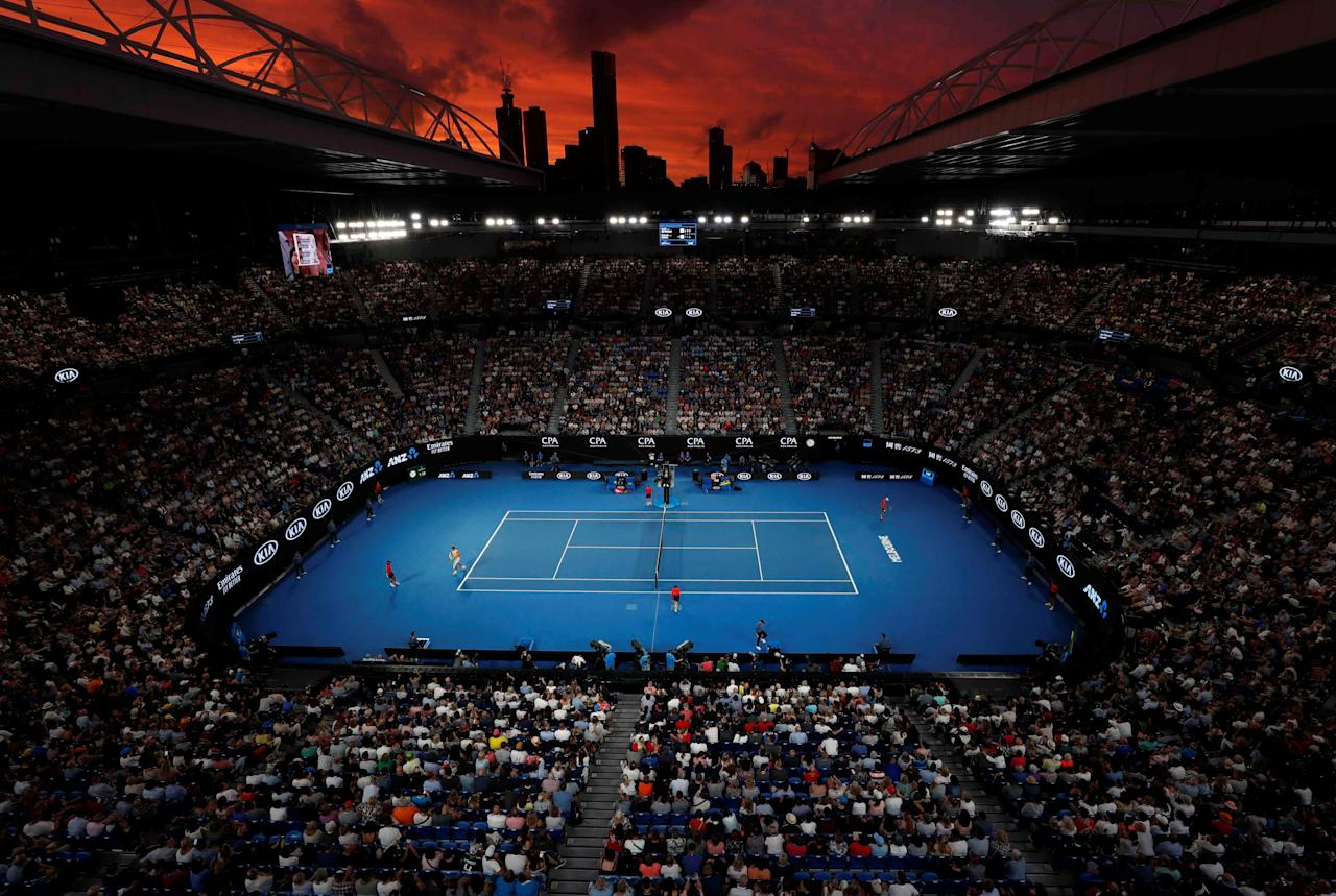 Tennis - Australian Open - Third Round - Melbourne Park, Melbourne, Australia, January 18, 2019. General view of the court and Melbourne skyline at sunset during Spain's Rafael Nadal and Australia's Alex de Minaur match. REUTERS/Aly Song     TPX IMAGES OF THE DAY