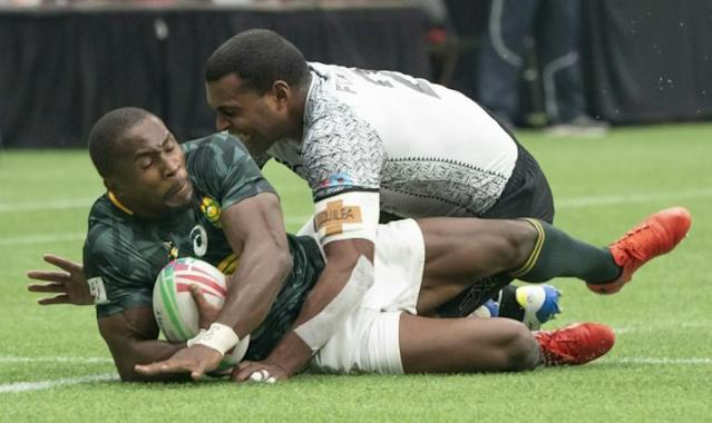 South Africa captain Siviwe Soyizwapi sealed victory for the Blitz Bokke in the Oktoberfest 7s final against Fiji with a try just before the final whistle in Munich. (AFP Photo/Rich Lam)
