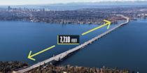 "<p><strong>Seattle, Washington</strong></p><p>The world's longest floating bridge was upstaged in April 2016 when the brand-new <a href=""https://www.popularmechanics.com/technology/infrastructure/g666/how-to-build-the-worlds-longest-floating-bridge/"" rel=""nofollow noopener"" target=""_blank"" data-ylk=""slk:State Route 520 Floating Bridge"" class=""link rapid-noclick-resp"">State Route 520 Floating Bridge</a> replaced it. The new span, which runs just a few feet to the north of the old Seattle bridge, spans 7,710 feet across Lake Washington and five vehicle lanes wide. The new bridge uses 77 concrete pontoons as the foundation; the weight of the water displaced by the pontoons equals the weight of the structure, allowing it to float. The roadway is elevated 20 feet above the water. A total of 58 anchors secure the bridge.</p>"