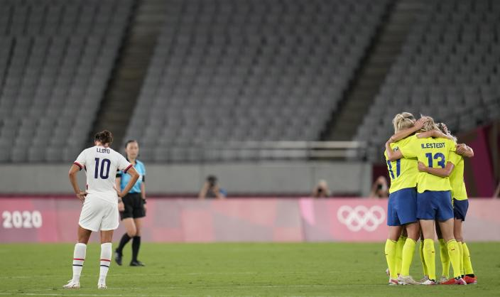 Sweden's players celebrate after beating 3-0 United States during a women's soccer match at the 2020 Summer Olympics, Wednesday, July 21, 2021, in Tokyo. (AP Photo/Ricardo Mazalan)