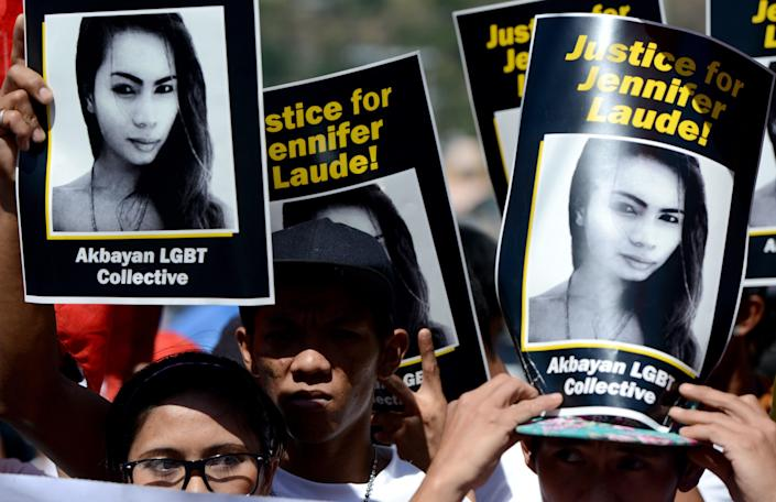 Supporters of the late Jennifer Laude hold up her image during a protest near a Philippine court in Olongapo, north of Manila, in a February 23, 2015 file photo. / Credit: NOEL CELIS/AFP/Getty
