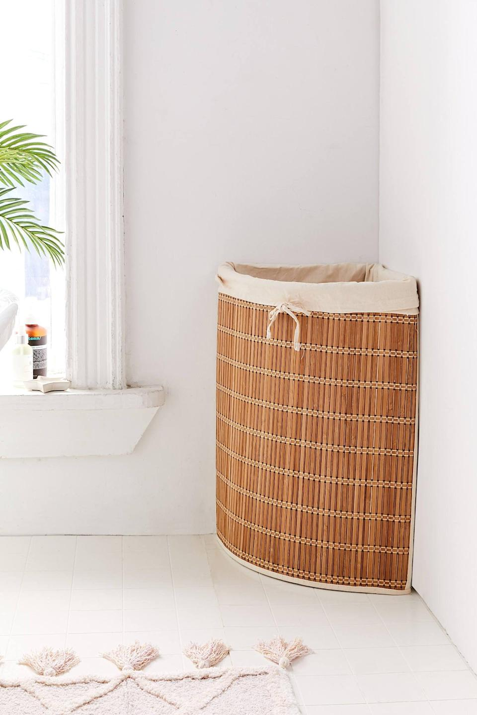 "<h3><a href=""https://www.urbanoutfitters.com/shop/wicker-corner-hamper"" rel=""nofollow noopener"" target=""_blank"" data-ylk=""slk:Urban Outfitters Wicker Corner Hamper"" class=""link rapid-noclick-resp"">Urban Outfitters Wicker Corner Hamper</a></h3><br><strong>When you don't have a closet to hide a hamper in</strong>: Instead of letting your dirty laundry pile up on the floor, store it inside a space-savvy wick hamper designed to tuck into an empty corner of your room.<br><br><strong>Urban Outfitters</strong> Wicker Corner Hamper, $, available at <a href=""https://go.skimresources.com/?id=30283X879131&url=https%3A%2F%2Fwww.urbanoutfitters.com%2Fshop%2Fwicker-corner-hamper"" rel=""nofollow noopener"" target=""_blank"" data-ylk=""slk:Urban Outfitters"" class=""link rapid-noclick-resp"">Urban Outfitters</a>"