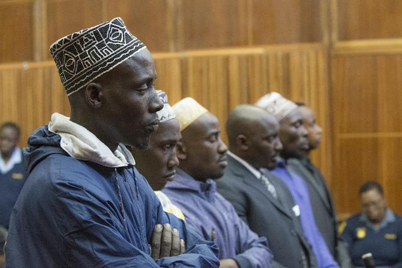 (From L) Sady Abdou, Hemedi Denengo Sefu, Amani Uriwane, Richard Bachisa, Hassann Nduli and Pascal Kanyandekwe listen on August 28, 2014 on the first day of their sentencing at the Kagiso Magistrate Court in Krugersdorp, South Africa