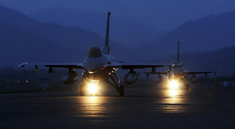 Handout photo of KF-16 fighter jets of the South Korean air force preparing to take off during a night flight operation at an air base in Chungju