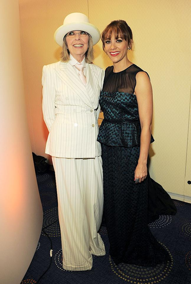 "Diane Keaton was all smiles in her usual suit, tie, and hat combo. The Oscar-winning actress, who attended the event as the invited guest of <i>People</i> magazine, posed with pretty ""Parks and Recreation"" star Rashida Jones, who sat at <i>Fortune</i>'s table."