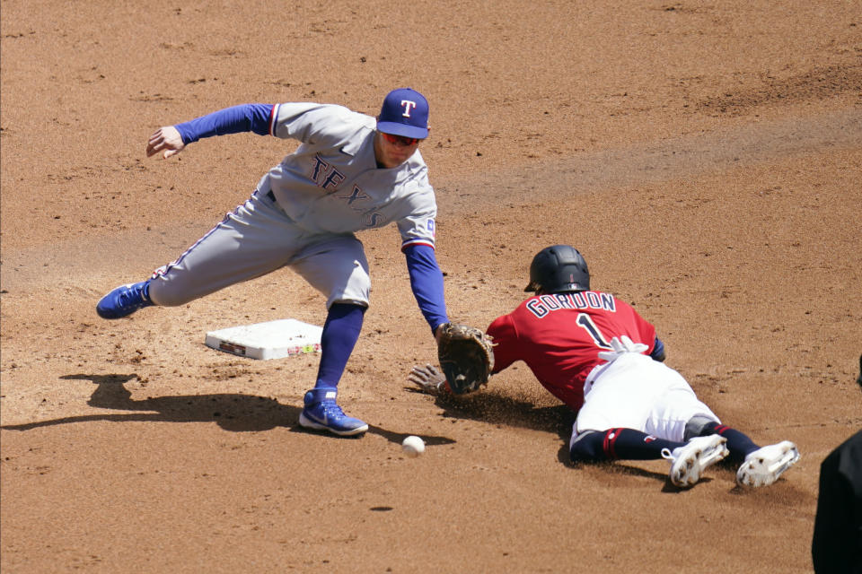 Minnesota Twins' Nick Gordon, right, steals second base as the throws gets past Texas Rangers second baseman Nick Solak in the second inning of a baseball game, Thursday, May 6, 2021, in Minneapolis. (AP Photo/Jim Mone)