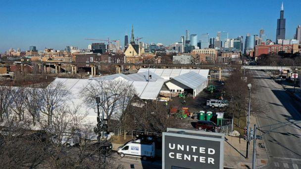 PHOTO: An aerial photo shot with a drone shows a COVID-19 vaccination center being constructed in a parking lot at the United Center, March 2, 2021 in Chicago. (Scott Olson/Getty Images)