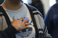 <p>A voter places a sticker on her chest after voting on Saturday in the South Carolina Democratic primary at a polling place at Sanders Middle School in Columbia, S.C. <i>(Photo: Gerald Herbert/AP)</i></p>