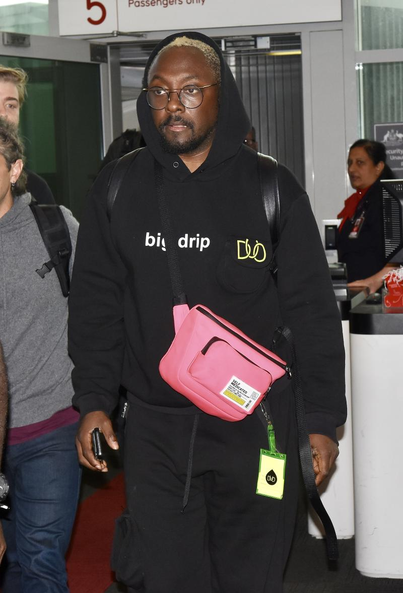Will.i.am was spotted at Sydney Airport after being escorted from a Qantas flight. Photo: DIIMEX