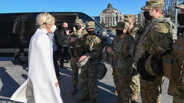 PHOTO: Lady Gaga greets National Guard soldiers as she leaves the U.S. Capitol building after rehearsing on Jan. 19, 2021, for the inauguration of President-elect Joe Biden in Washington, D.C. (Roberto Schmidt/AFP via Getty Images)