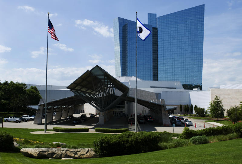 This June 10, 2012 photo shows the Mohegan Sun casino in Uncasville, Conn. A gaming slump is eating into the profits of Mohegan Sun in 2014, but the 2,000 tribal members who draw benefits from the massive casino are not feeling the pinch. The tribe's gaming company has begun running casinos in Pennsylvania and Atlantic City, and it is pursuing more projects in states including Washington, New York, and Massachusetts. (AP Photo/Jessica Hill)