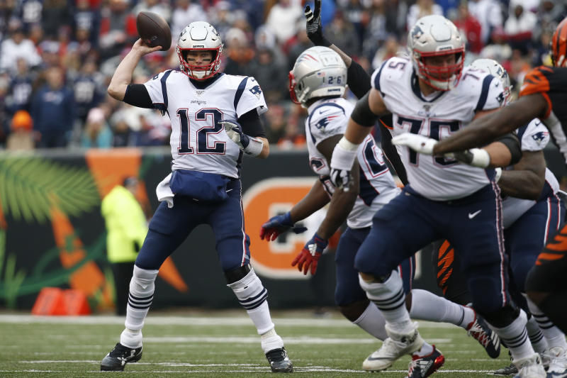 File-This Dec. 15, 2019, file photo shows New England Patriots quarterback Tom Brady (12) passing in the second half of an NFL football game against the Cincinnati Bengals, in Cincinnati. Members of a special panel of 26 selected all of them for the position as part of the NFL's celebration of its 100th season. All won league titles except Marino. All are in the Hall of Fame except Brady and Manning, who are not yet eligible.  On Friday, Dec. 27, 2019, quarterback was the final position revealed for the All-Time Team. (AP Photo/Frank Victores, File)