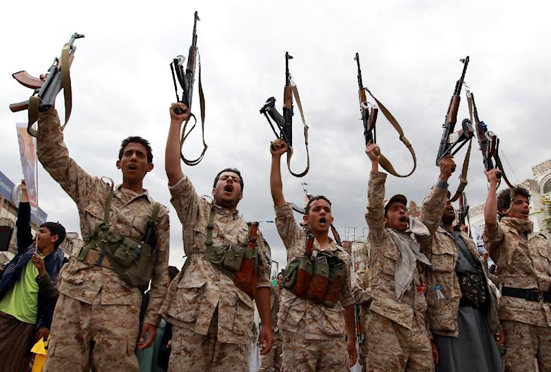 Yemeni men loyal to the Huthi movement brandish their weapons on March 26, 2015 during a gathering in Sanaa