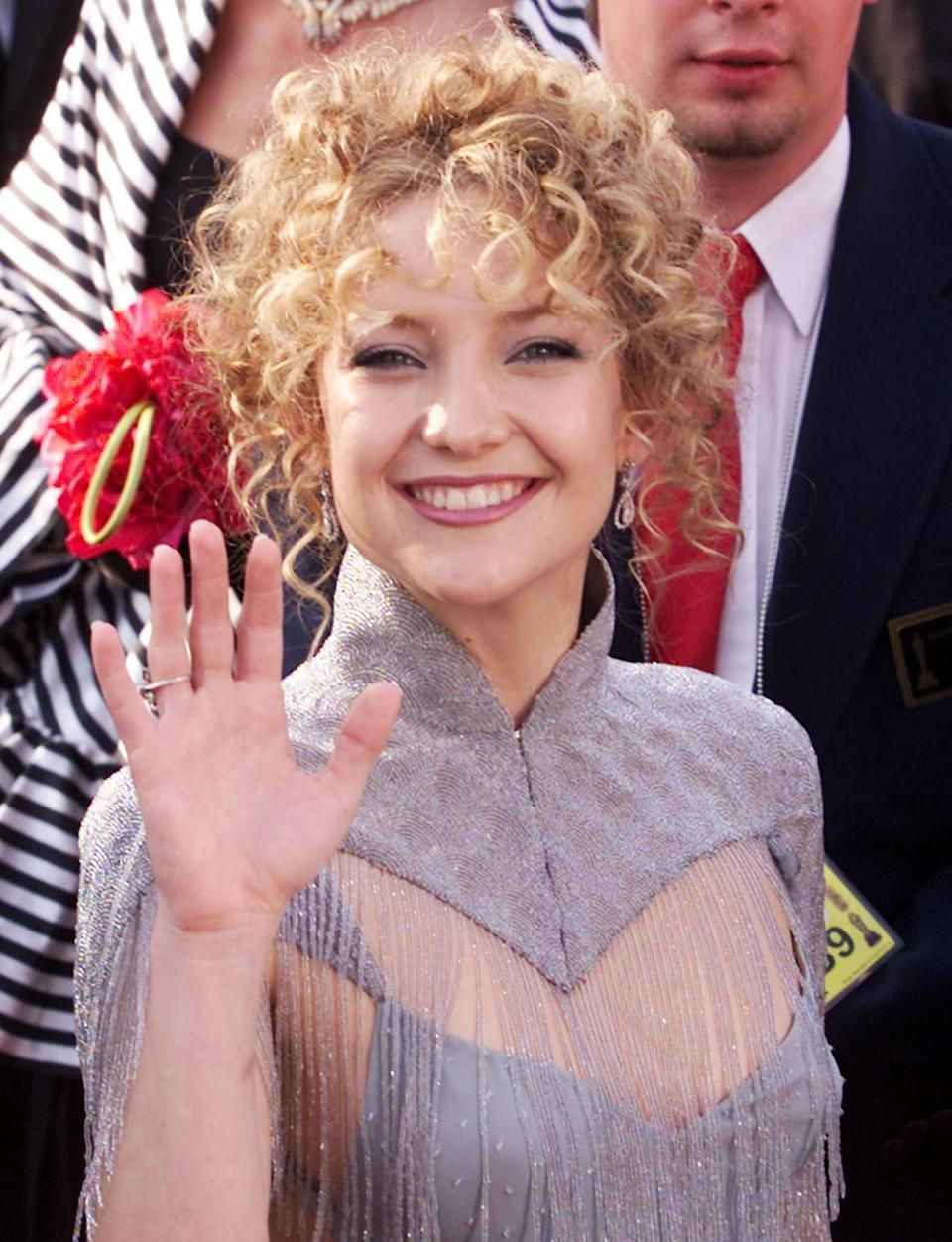 """<p>Nominated for her role in <em>Almost Famous</em>, Kate Hudson smiled big on the red carpet while rocking a curly updo and beaded lilac gown. (<a href=""""https://people.com/style/celebrity-biggest-style-regrets/?slide=6074256#6074256"""" rel=""""nofollow noopener"""" target=""""_blank"""" data-ylk=""""slk:She had regrets later, she has said"""" class=""""link rapid-noclick-resp"""">She had regrets later, she has said</a>.)</p>"""