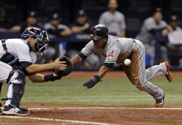 Cleveland Indians' Jose Ramirez, right, scores ahead of the throw to Tampa Bay Rays catcher Nicholas Ciuffo on a fielder's choice by Yonder Alonso during the seventh inning of a baseball game Monday, Sept. 10, 2018, in St. Petersburg, Fla. (AP Photo/Chris O'Meara)