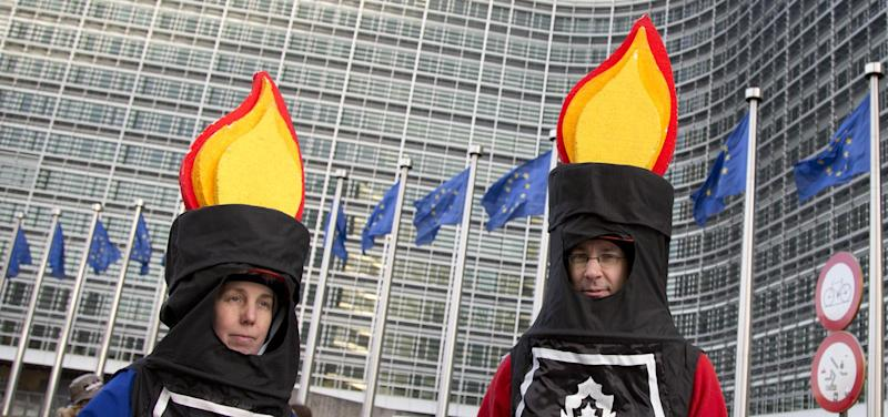 Protestors from an anti-fracking group wait for the start of a demonstration outside EU headquarters in Brussels on Wednesday, Jan. 22, 2014. The European Commission on Wednesday proposed a framework for climate and energy policies beyond 2020 and up to 2030. (AP Photo/Virginia Mayo)