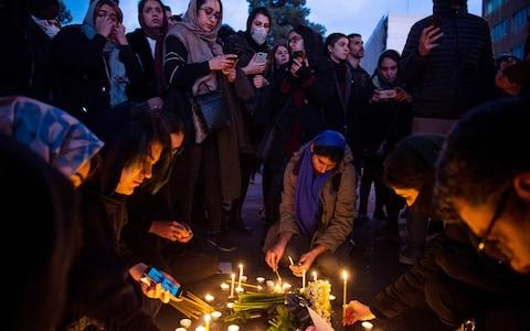 <span>Demonstrators light candles while gathering during a vigil for the victims of the Ukraine International Airlines flight</span> <span>Credit: Ali Mohammadi/Bloomberg </span>