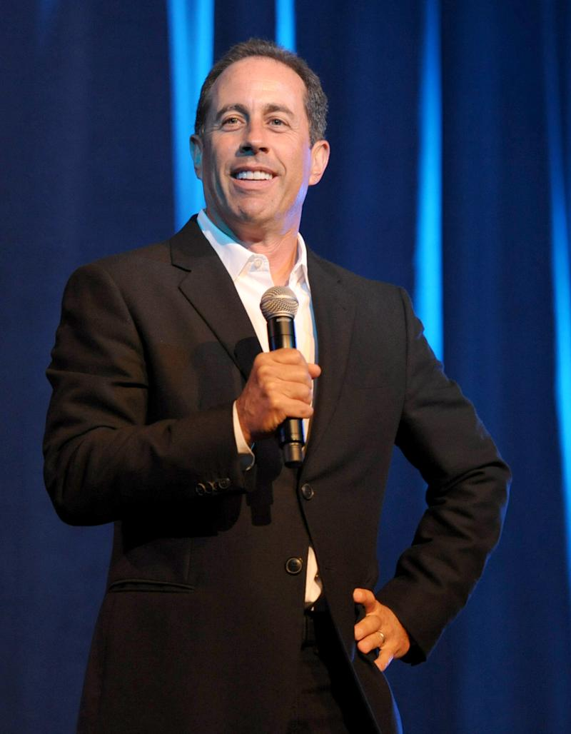 "FILE - This June 30, 2012 file photo shows comedian Jerry Seinfeld performing at the David Lynch Foundation: A Night of Comedy honoring George Shapiro in Beverly Hills, Calif. Seinfeld will receive a Webby for Outstanding Comedic Performance for his hit Web series ""Comedians in Cars Getting Coffee."" The 10-episode series, which chronicles the conversations between Seinfeld and his comedian friends, including Ricky Gervais, Alec Baldwin and Larry David, demonstrated the continued merging of Hollywood-style entertainment with the Internet. (Photo by John Shearer/Invision/AP, File)"