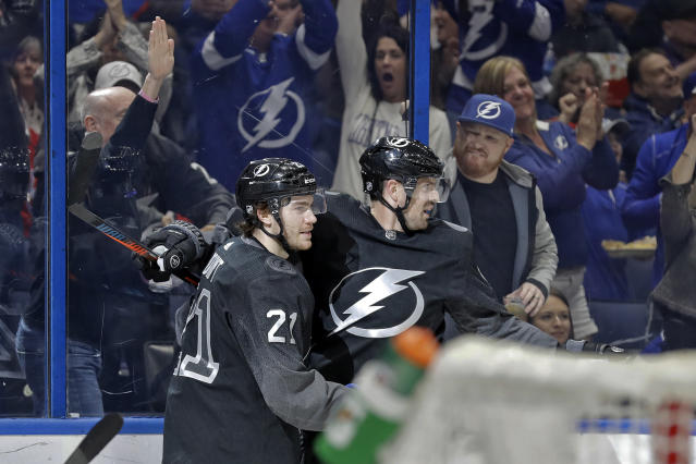 Tampa Bay Lightning center Brayden Point (21) celebrates his goal against the Washington Capitals with left wing Alex Killorn (17) during the second period of an NHL hockey game Saturday, Dec. 14, 2019, in Tampa, Fla. (AP Photo/Chris O'Meara)