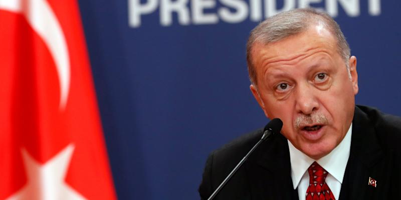 Turkey's President Recep Tayyip Erdogan speaks during a joint news conference after talks with his Serbian counterpart Aleksandar Vucic in Belgrade, Serbia, Monday, Oct. 7, 2019. Erdogan is on a two-day official visit to Serbia. (AP Photo/Darko Vojinovic)