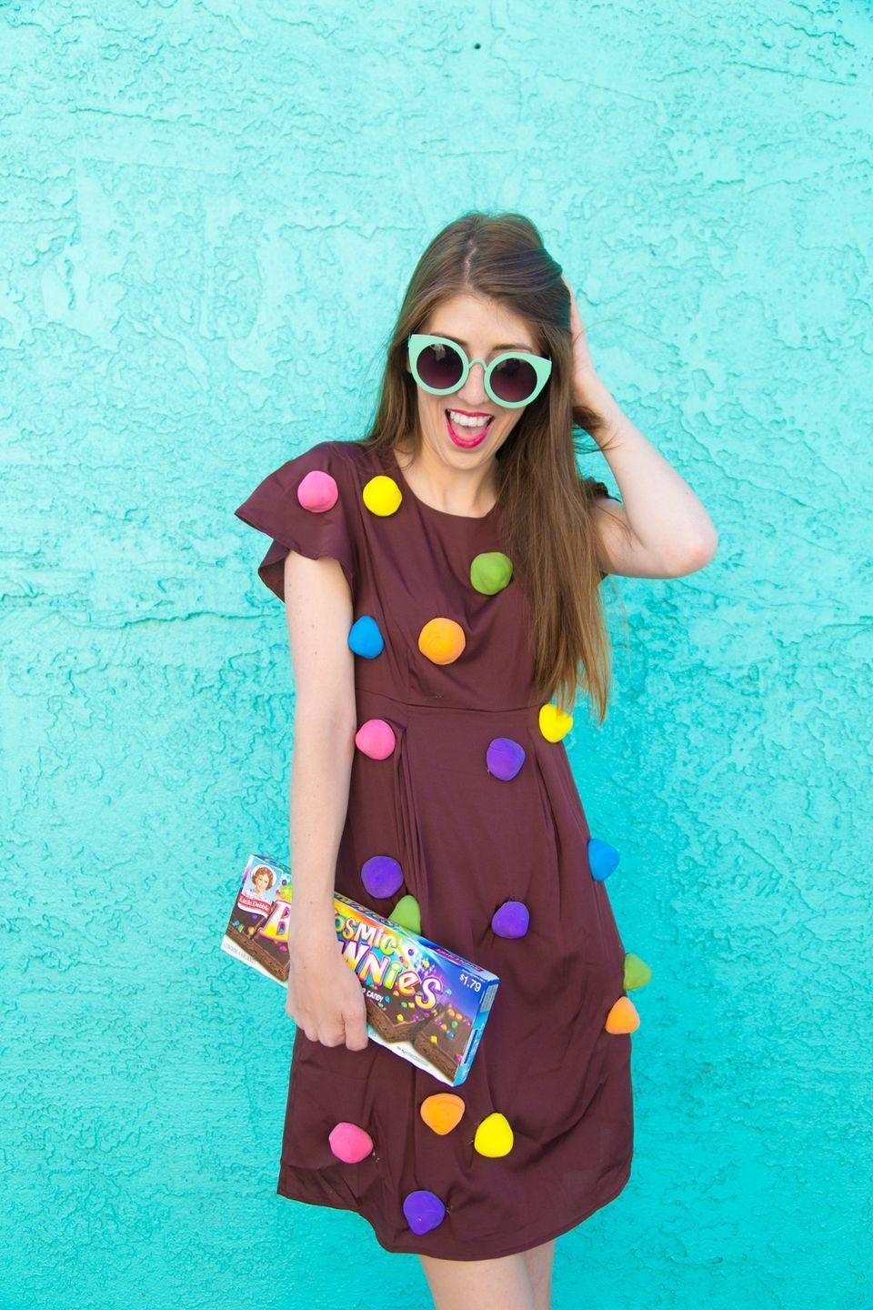 """<p>Here's a sweet idea: Dress as one of the most beloved sleepover treats of the 1990s. </p><p><em><a href=""""https://studiodiy.com/diy-cosmic-brownie-costume//"""" rel=""""nofollow noopener"""" target=""""_blank"""" data-ylk=""""slk:Get the tutorial."""" class=""""link rapid-noclick-resp"""">Get the tutorial.</a></em></p><p><a class=""""link rapid-noclick-resp"""" href=""""https://www.amazon.com/Wenrine-Womens-Sleeveless-Bodycon-Stretchy/dp/B08M5ZF85H/?tag=syn-yahoo-20&ascsubtag=%5Bartid%7C10072.g.37059504%5Bsrc%7Cyahoo-us"""" rel=""""nofollow noopener"""" target=""""_blank"""" data-ylk=""""slk:SHOP DRESS"""">SHOP DRESS</a></p>"""