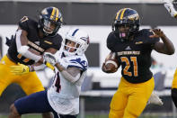Southern Mississippi running back Frank Gore Jr. (21) is assisted by wide receiver Jason Brownlee's (17) block on UTSA safety SaVion Harris, as he scores on a 51-yard touchdown pass reception during the second half of an NCAA college football game, Saturday, Nov. 21, 2020, in Hattiesburg, Miss. UTSA won 23-20. (AP Photo/Rogelio V. Solis)