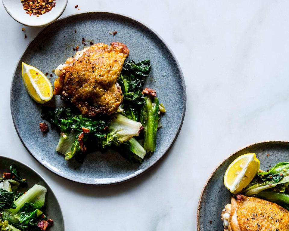 """A single pan leads to many wonders: crackly-skinned chicken, hardy escarole, and a touch of smoky bacon. <a href=""""https://www.bonappetit.com/recipe/crispy-chicken-thighs-with-bacon-and-wilted-escarole?mbid=synd_yahoo_rss"""" rel=""""nofollow noopener"""" target=""""_blank"""" data-ylk=""""slk:See recipe."""" class=""""link rapid-noclick-resp"""">See recipe.</a>"""