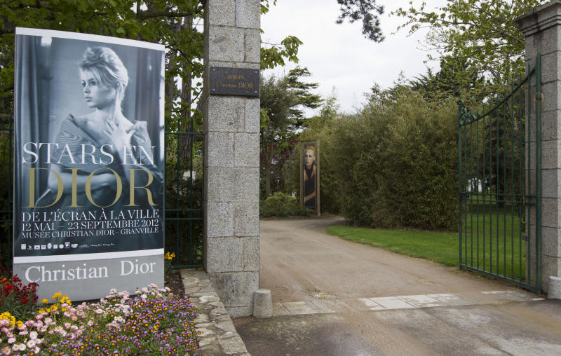 The entrance leading to the childhood home of designer Christian Dior in Granville, Normandy, France, Thursday, May 10, 2012. Going back to where it all began, a new exhibit in the childhood home of legendary designer Christian Dior in Normandy sheds new light on the house's huge contribution to the silver screen. The setting also provides rare insight into how a young Dior - a mama's boy who liked to spend time in the garden - became inspired by the Granville landscape and decided to dedicate his life to fashion. (AP Photo/Jacques Brinon)