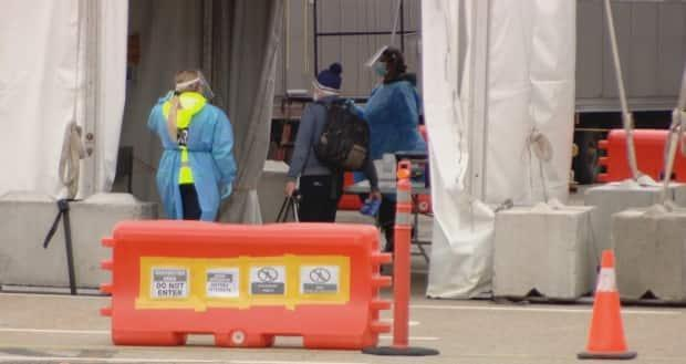 After pedestrians cross into Canada, they are escorted into a tent, shown here at the Rainbow Bridge in Niagara Falls. There they are screened and told about COVID-19 protocols.