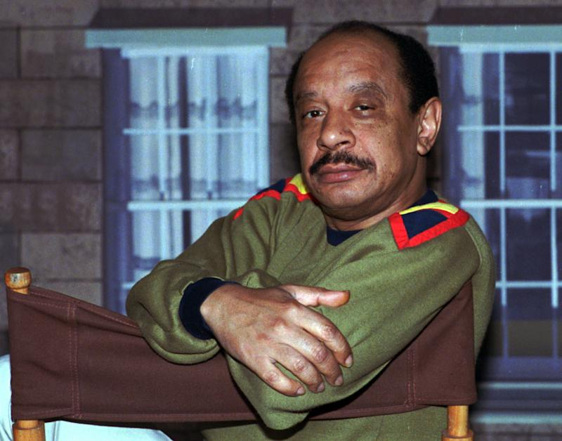 """FILE - In this Aug. 11, 1986 file photo, actor Sherman Hemsley poses for a photo in Los Angeles. Hemsley, the actor who made the irascible, bigoted George Jefferson of """"The Jeffersons"""" one of television's most memorable characters and a symbol for urban upward mobility, was found dead Tuesday, July 24, 2012 at his El Paso, Texas home. He was 74. (AP photo/Nick Ut, File)"""