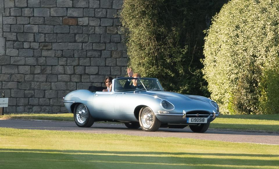 The newlyweds departed Windsor Castle in a vintage Jaguar [Photo: Getty]