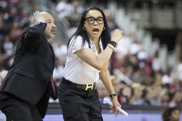 South Carolina head coach Dawn Staley, right, communicates with players during the first half of an NCAA college basketball game against Mississippi State, Sunday, March 3, 2019, in Columbia, S.C. (AP Photo/Sean Rayford)