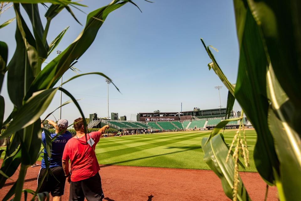 Members of the media tour the new stadium where Major League Baseball will host tomorrow's game between the New York Yankees and the Chicago White Sox near the Field of Dreams movie site outside of Dyersville, Wednesday, Aug. 11, 2021.