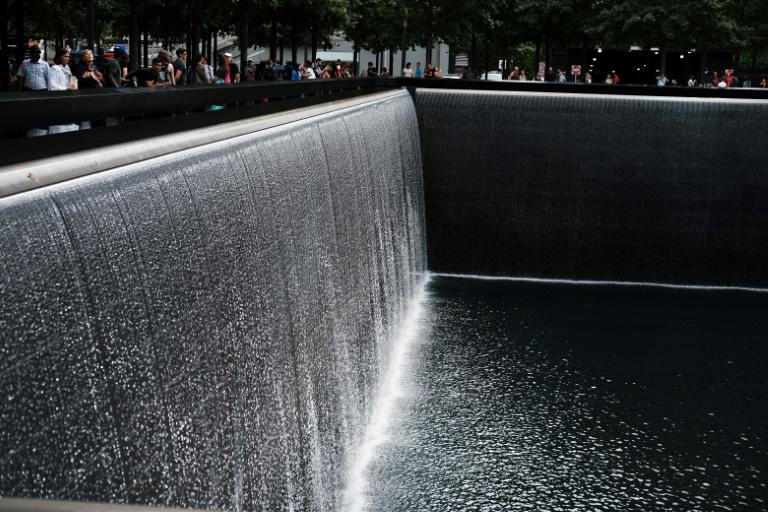 People walk on the grounds of the September 11 Memorial and Museum on September in New York City