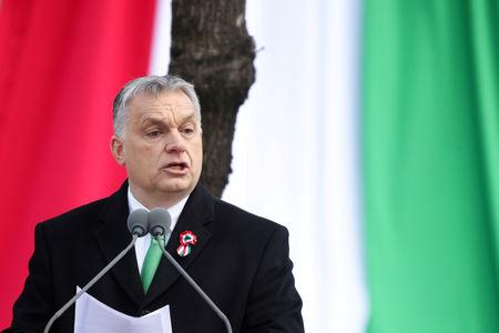 FILE PHOTO: Hungarian Prime Minister Viktor Orban speaks during Hungary's National Day celebrations in Budapest, Hungary, March 15, 2019. REUTERS/Lisi Niesner/File Photo
