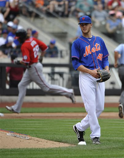 New York Mets starting pitcher Zack Wheeler (45) reacts on the mound as Washington Nationals' Jayson Werth (28) rounds third base after hitting a solo home run in the third inning of a baseball game at Citi Field on Sunday, June 30, 2013 in New York. (AP Photo/Kathy Kmonicek)