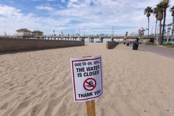 PHOTO: A warning sign is posted for people to stay out of the water after a major oil spill off the coast of California came ashore in Huntington Beach, Calif., Oct. 4, 2021. (Mike Blake/Reuters)
