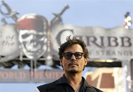 "Depp poses at the premiere of ""Pirates of the Caribbean: On Stranger Tides"" at Disneyland in Anaheim"