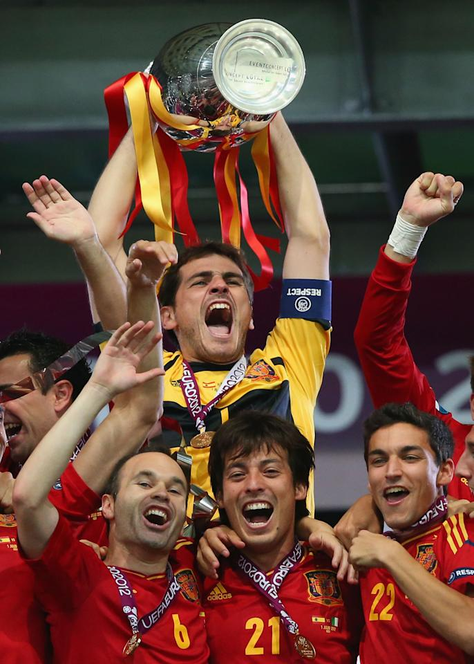 KIEV, UKRAINE - JULY 01: Captain Iker Casillas of Spain lifts the trophy after victory during the UEFA EURO 2012 final match between Spain and Italy at the Olympic Stadium on July 1, 2012 in Kiev, Ukraine.  (Photo by Alex Livesey/Getty Images)