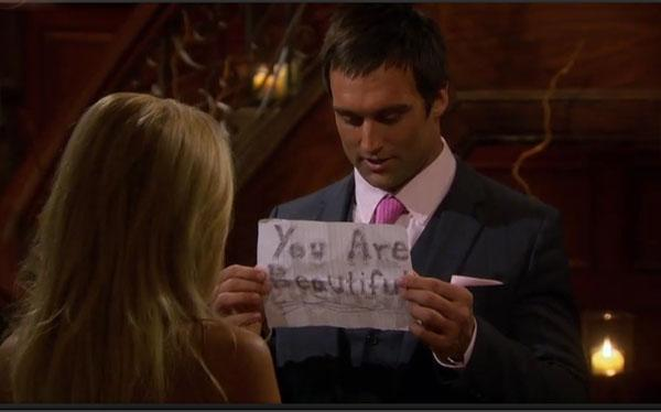 "Ryan, the pro sports trainer, went the sweet (albeit high school) route  and held up a sign on notebook paper that said ""You are beautiful"" on  one side and ""I'm so nervous"" on the other. Not a bad approach for the  tongue-tied suitor."