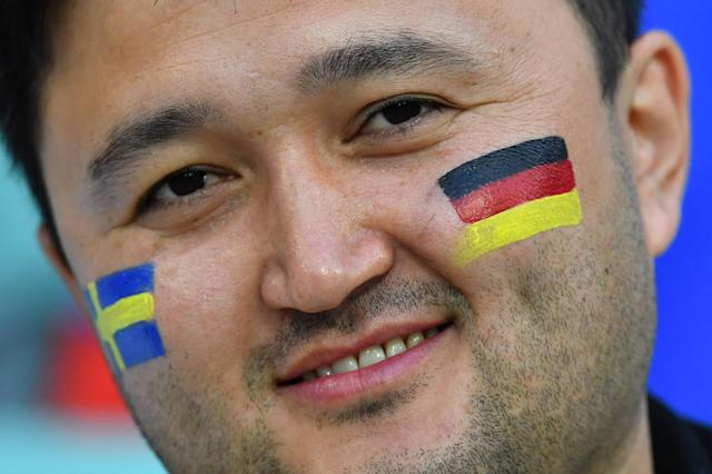 Soccer Football - World Cup - Group F - Germany vs Sweden - Fisht Stadium, Sochi, Russia - June 23, 2018 Fan with Sweden and Germany face paint inside the stadium before the match REUTERS/Dylan Martinez