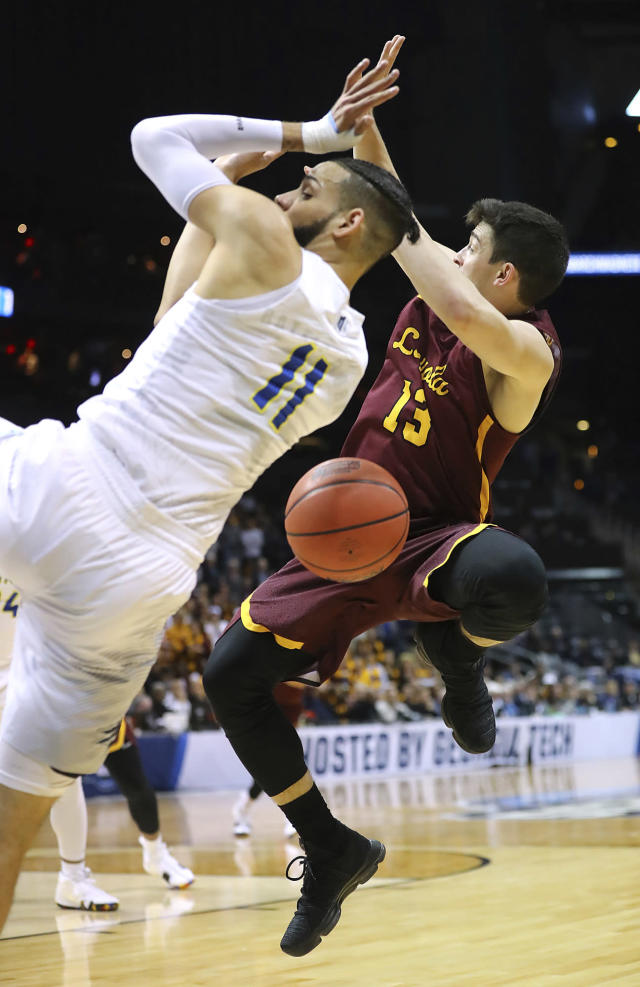 Loyola-Chicago guard Clayton Custer loses the ball as he is fouled by Nevada forward Cody Martin, left, during the first half of an NCAA men's college basketball tournament regional semifinal Thursday, March 22, 2018, in Atlanta. (Curtis Compton/Atlanta Journal-Constitution via AP)