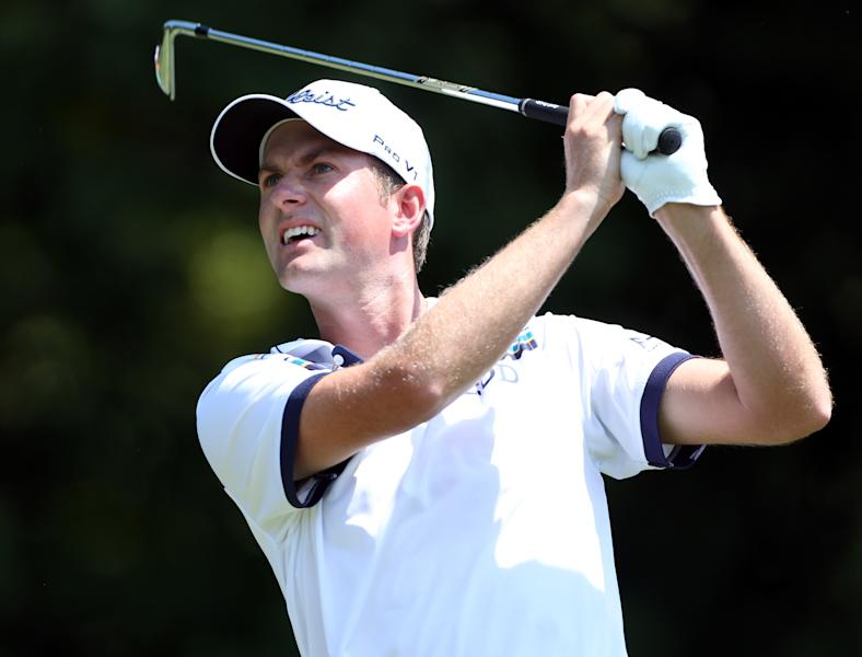 Webb Simpson of the US plays his tee shot on the seventh hole during the first round of the Wyndham Championship, at Sedgefield Country Club in Greensboro, North Carolina, on August 14, 2014 (AFP Photo/Todd Warshaw)