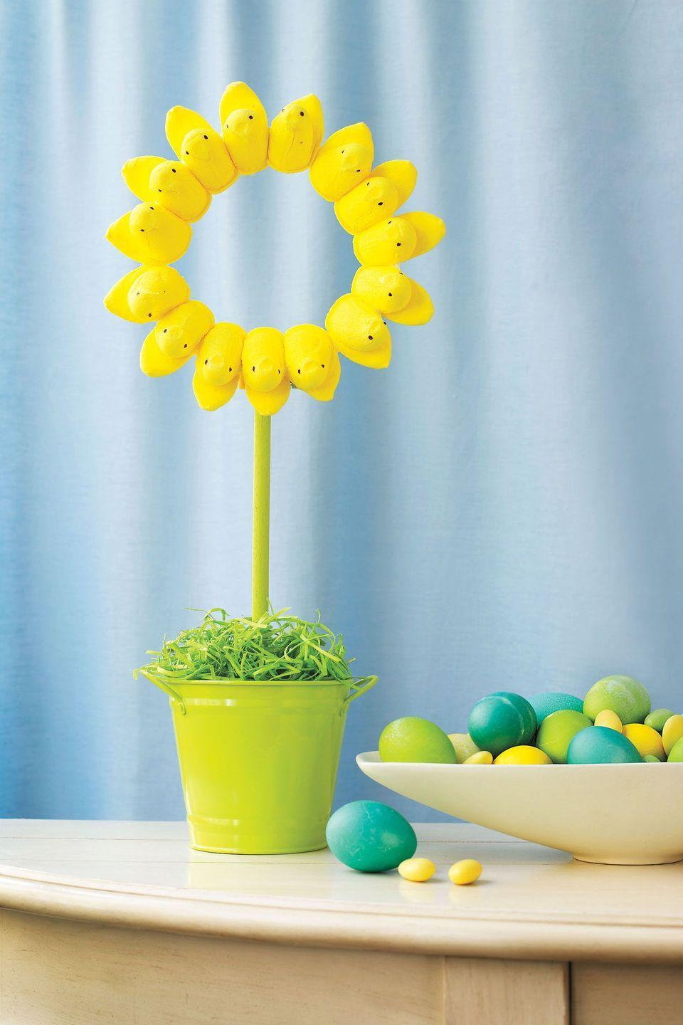 """<p>Celebrate Easter and the arrival of spring with a cute and sweet DIY project. </p><p><strong><em><a href=""""https://www.womansday.com/home/crafts-projects/how-to/g238/easter-craft-how-to-peeps-sunflower-116413/"""" rel=""""nofollow noopener"""" target=""""_blank"""" data-ylk=""""slk:Get the Peeps Sunflower tutorial."""" class=""""link rapid-noclick-resp"""">Get the Peeps Sunflower tutorial.</a></em></strong></p><p><strong><a class=""""link rapid-noclick-resp"""" href=""""https://www.amazon.com/Marshmallow-Peeps-Yellow-Chicks-Tray/dp/B00BA0BJOA?tag=syn-yahoo-20&ascsubtag=%5Bartid%7C10070.g.1751%5Bsrc%7Cyahoo-us"""" rel=""""nofollow noopener"""" target=""""_blank"""" data-ylk=""""slk:SHOP PEEPS"""">SHOP PEEPS</a></strong></p>"""