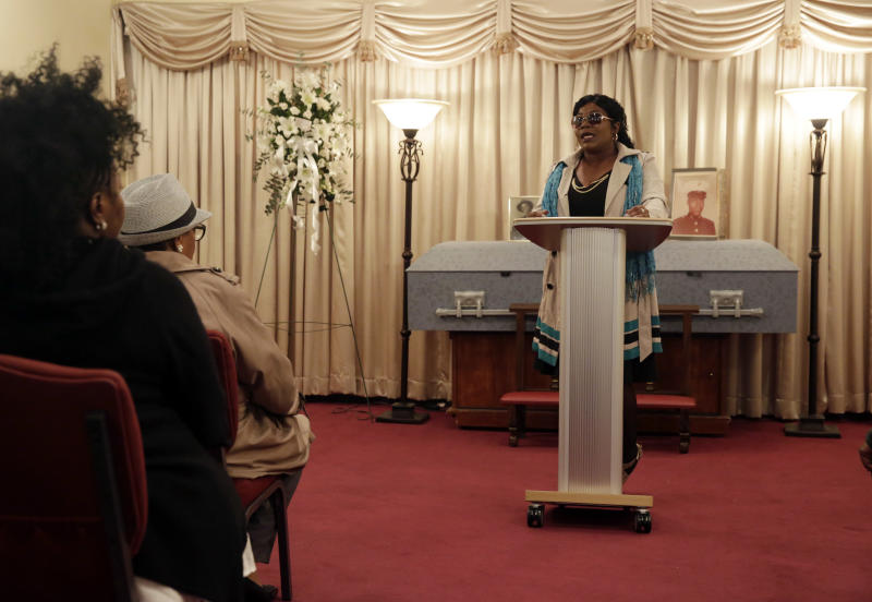 Cheryl Warner, the sister of Jerome Murdough, delivers remarks during his funeral at the Cobbs Funeral Chapel, in the Queens borough of New York, Friday, April 25, 2014. A modest family funeral was held for 56-year-old Jerome Murdough, a homeless former Marine who was found dead more than two months ago in an overheated New York City jail cell. (AP Photo/Richard Drew)